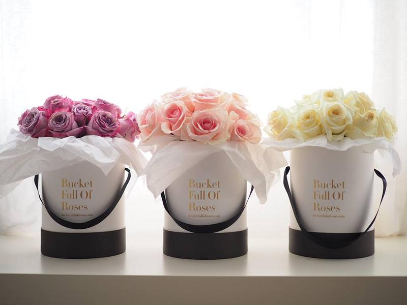 Bucket full of roses flowers delegate singapore event planning white pink flower petal mightylinksfo